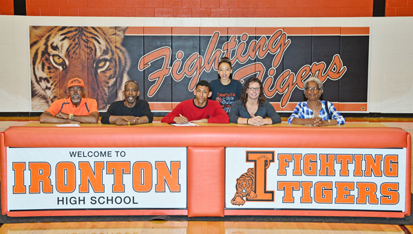Ironton Fighting Tigers' senior guard Marques Davis signed a letter-of-intent with the University of Rio Grande on Wednesday. Attending the signing ceremony were: from left tor right, grandfather Oatis Davis, father Marq Davis, Marques, sister Victoria Hill, mother Michelle Easterling and grandmother Jackie Davis. (Kent Sanborn of Southern Ohio Sports Photos)