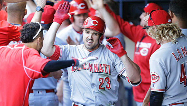 Cincinnati's Adam Duvall (23) celebrates with teammates in the dugout after hitting a game-tying three-run homer in the seventh inning. The Reds beat the Milwaukee Brewers 7-6 on Saturday to snap an 11-game losing streak. (Photo Courtesy of The Cincinnati Reds.com/Mike McGinnis of Getty Images)
