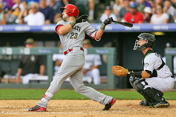 Cincinnati Reds' Adam Duvall (23) hits a two-run homer in the fourth inning of Monday's 11-8 win over the Colorado Rockies. Duvall also hit a solo home run in the ninth inning as the Reds belted five round-trippers in the win. (Photo Courtesy of The Cincinnati Reds.com/Justin Edmonds/Getty Images )
