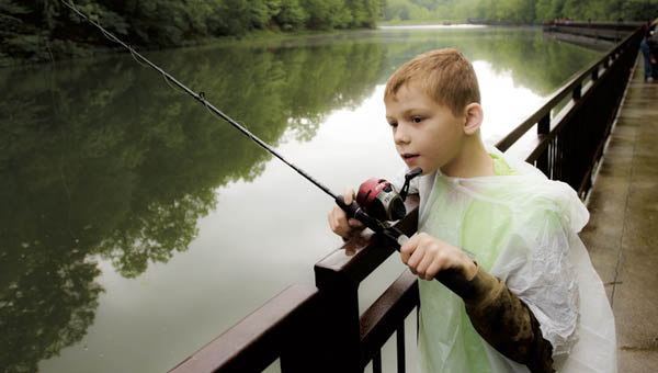 Markus Dust, of Pedro, takes part in the youth fishing derby at Lake Vesuvius on Saturday morning.