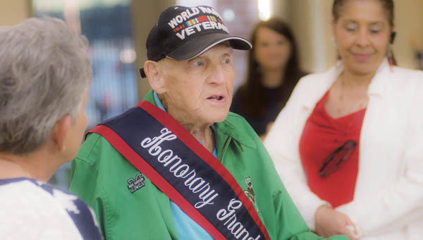 World War II veteran Paul Salyer addresses friends and family during the Past Grand Marshal Dinner. Salyer is this year's Honorary Grand Marshal.