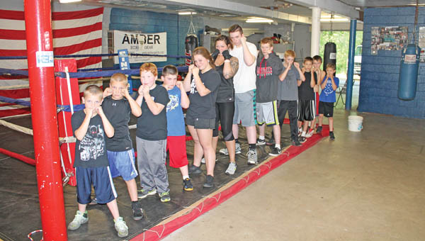 Area children who train and box at the Westwood Boys and Girls Club. From front to back: Steeler Waulk, 8, Bryan Wilburn, 11, Hunter Johnson, 9, Blake Waulk, 11, Amaya Waulk, 15, Alicia Smith (mentor), 33, Bailey Evans, 17, Matt Hogsten, 16, Justin Newcomb, 12, Blake Earnest, 13, Gavin Cordle, 11 and Tyler Earnest, 9.