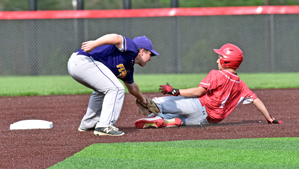 St. Joseph Flyers' shortstop Seth Kelly (left) puts the tag on Rock Hill's Jake Blagg as he slides into second base. The Redmen blanked the Flyers 3-0. (Kent Sanborn of Southern Ohio Sports Photos)