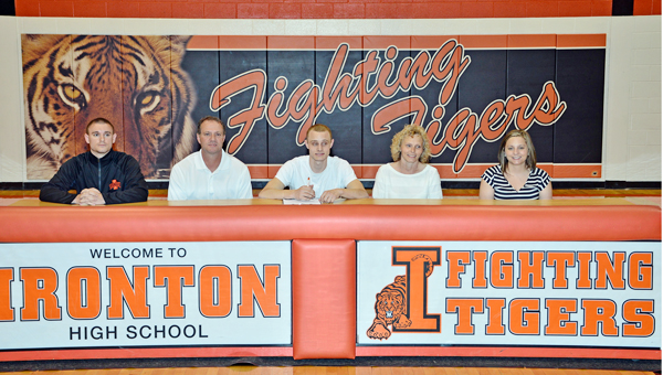 Ironton Fighting Tigers' senior point guard Phillip Kratzenberg signed a letter-of-intent to play basketball at the University of Rio Grande on Wednesday. Attending the signing ceremony were: from left to right, brother and Ironton assistant coach Chase Kratzenberg, father Robert Kratzenberg, Phillip, mother Kim Kratzenberg and sister Cassie Kratzenberg. (Kent Sanborn of Southern Ohio Sports Photos)