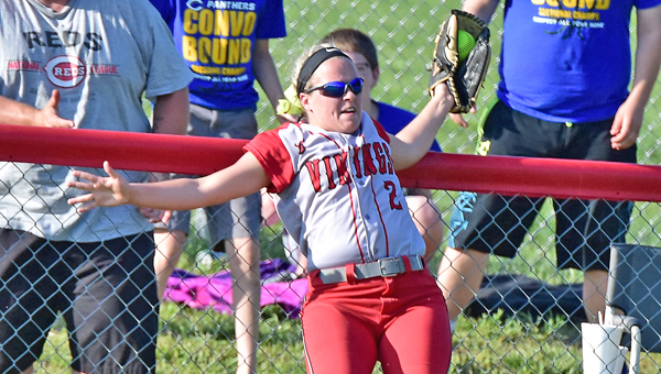 Symmes Valley Lady Vikings' Hannah Mays crashes into the fence as she robs a possible home run by Portsmouth Clay. Symmes Valley beat Clay 8-1 to win the district title. (Kent Sanborn of Southern Ohio Sports Photos)