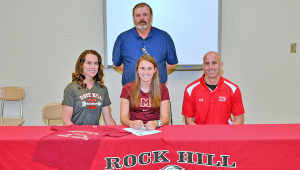 Rock Hill Redwomen senior cross country standout Sarah McFann signed a letter-of-intent with Maryville (TN.) College on Thursday. Attending the ceremony were: seated left to rigth, mother Beth, Sarah, father and coach Mark McFann; standing is athletic director Barry Litteral. (Kent Sanborn of Southern Ohio Sports Photos)
