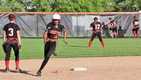 Ironton Lady Fighting Tigers' Zjaytayia Mize (15) rounds second base en route to hitting an inside-the-park home run during Friday's Division III sectional tournament championship game. Ironton outscored the Coal Grove Lady Hornets 14-10. (Tim Gearhart of Tim's News & Novelties, Park Ave. in Ironton)