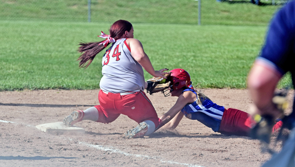 Symmes Valley Lady Vikings' Hannah Newcomb (34) tags out a Peebles' baserunner during Thursday's Division IV district semifinal tournament game. The Lady Vikings won 5-0 and play Portsmouth Clay at 1 p.m. on Saturday in the district championship game at Minford High School. (Kent Sanborn of Southern Ohio Sports Photos)