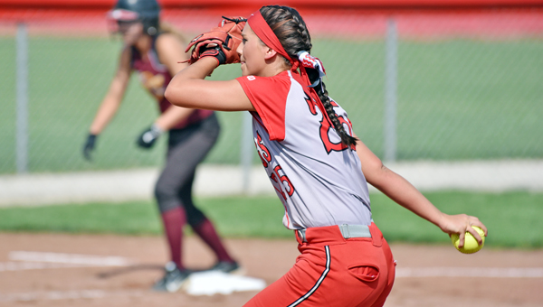 Symmes Valley Lady Vikings' Kaitlyn Payne pitches a three-hitter during Thursday's Division IV sectional final tournament game. The Lady VIkings routed Federal Hocking 15-0 in five innings to earn a trip to the district semifinals. (Robert S. Stevens of The Gold Studio in Ironton)