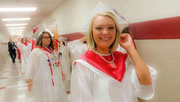 Abigail Leigh Marshall waits with her fellow classmates before commencement exercises at Rock Hill High School Saturday morning.