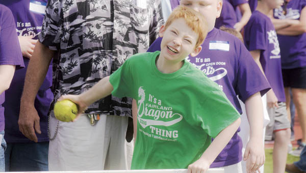 Fairland schools student Eli Collins participates in the softball throw Thursday during the Annual Lawrence County Special Olympics at South Point High School.