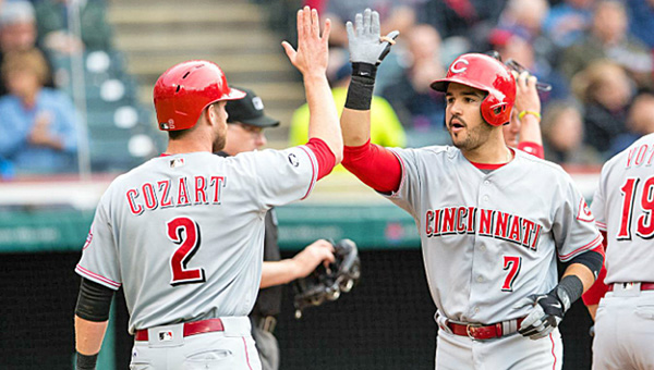 Cincinnati Reds' Eugenio Suarez celebrates with Zack Cozart after hitting a home run in the third inning. Suarez' home run wasn't enough as the Reds lost to the Cleveland Indians 15-6. (Courtesy Jason Miller/Getty Images/For Cincinnati Reds.com)