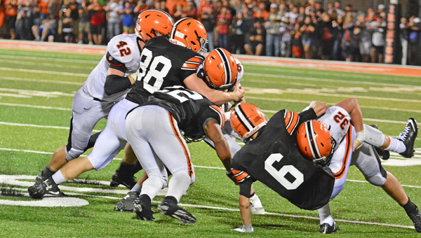 Ironton Fighting Tigers' Tanner Wilson (88) makes the stop of a Wheelersburg running back during a game last season. Wilson has been invited to the All-American Blue-Grey Super  Football Combine. (Kent Sanborn of Southern Ohio Sports Photos)