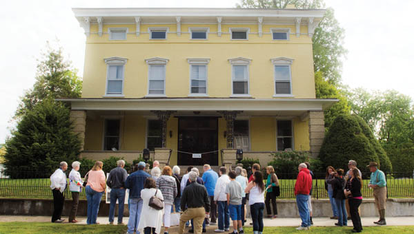 Eventgoers gather outside the John Campbell house as they take part in the Iron Furnace History Tour Saturday morning.