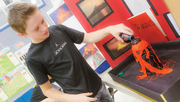 Trenton Roman presents his volcano project during the Burlington Elementary Science Fair by the fifth grade Tuesday morning.