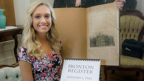Rock Hill High School senior Shelby Dalton and Kay Radar, with the Lawrence County Historical Museum, displaying copies of Ironton Register and the original Ironton Register.
