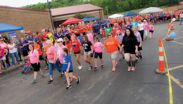 Supporters of the Symmes Valley Relay for Life take part in the survivors lap Friday.
