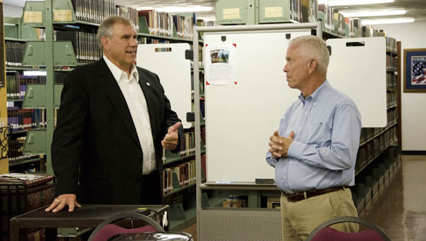 Tri-State Bible College President Jack Finch, tells U.S. Rep. Bill Johnson, R-Ohio, about the need to expand the school's library during a visit by the congressman to the campus on Tuesday.