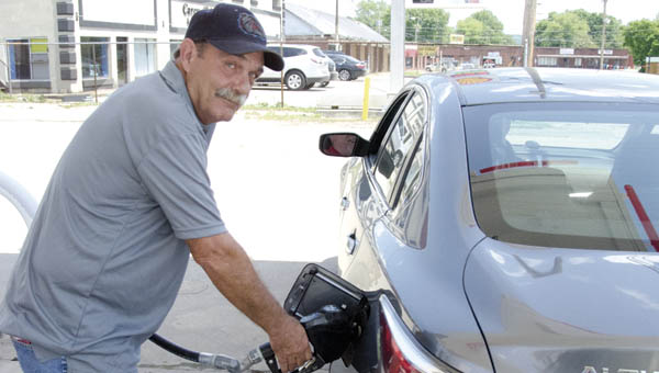 Sonny Rice pumps gas at the Silver Star Shell station in Rome Township.
