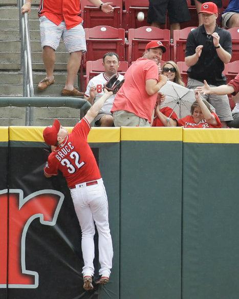 Cincinnati Reds' rightfielder Jay Bruce can't quite catch a home run ball hit by Washington's Wilson Ramos in the fourth inning of Sunday's game. The Reds lost to the Nationals 10-9. (Photo Courtesy of The Cincinnati Reds.com/John Minchillo - AP)