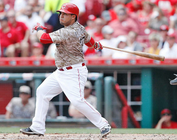Cincinnati's catcher Ramon Cabrera doubles home a run in the second inning of Sunday's game. It proved to be the only run for the Reds as they lost 6-1 to the Oakland Athletics. (Courtesy of The Cincinnati Reds.com/Joe Robbins — Getty Images)