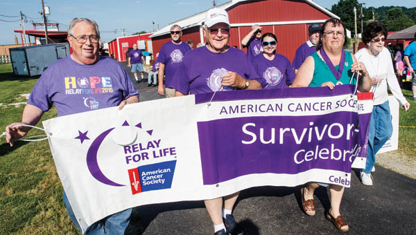 Participants in Friday evening's Relay for Life walk the survivors' lap at the start of the event at the Lawrence County Fairgrounds.