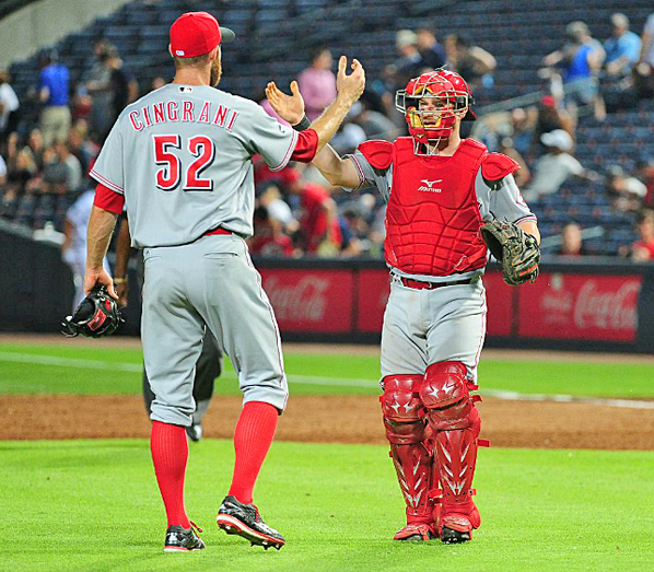 Cincinnati Reds' reliever Tony Cingrani (52) and catcher Tucker Barnhart congratulate each other after beating the Atlanta Braves 9-8 on Monday. (Courtesy of The Cincinnati Reds.com/Scott Cunningham — Getty Images)