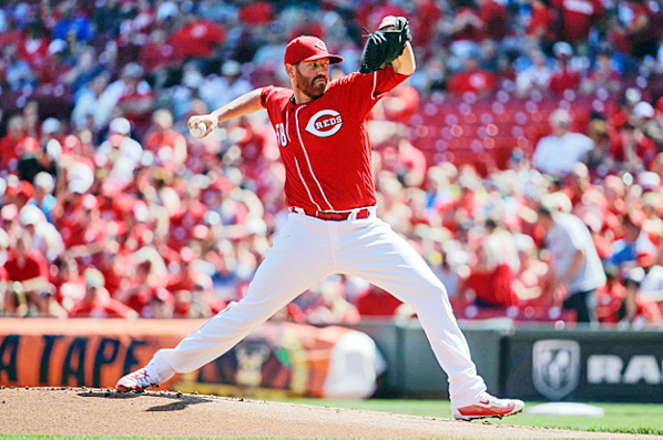 Cincinnati's Dan Straily pitched six strong innings and Jay Bruce hit a two-run homer as the Reds beat the Oakland A's 2-1 on Saturday. (Courtesy of The Cincinnati Reds.com/John Minchillo — AP)