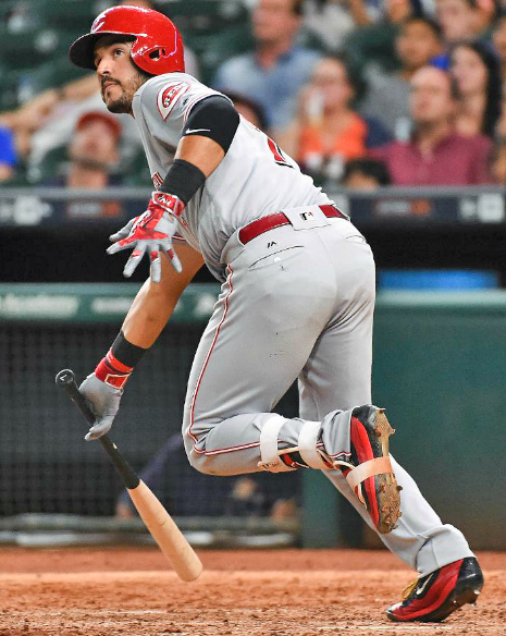Cincinnati's Eugenio Suarez hits a go-ahead RBI double in the 11th inning on Friday as the Reds beat the Houston Astros 4-2. (Photo courtesy The Cincinnati Reds.com/Eric Christian Smith — AP)