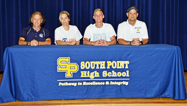 South Point Pointers' senior track standout Stephen Wagoner signed a letter-of-intent on Tuesday with the Shawnee State University Bears. Attending the ceremony were: from left to right, Shawnee State head coach Eric Putnam, mother Ann Clay, Stephen and Pointers' head coach Todd Wells. (Kent Sanborn of Southern Ohio Sports Photos)