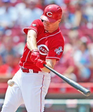 Cincinnati Reds' first baseman Jay Bruce connects for an RBI single in the third inning on Sunday against the Arizona Diamondbacks. The Reds lost a 9-8 slugfest to the Diamondbacks. (Courtesy of The Cincinnati Reds.com/Aaron Doster — The Associated Press)