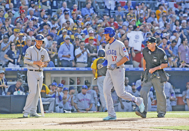 The Chicago Cubs' Kris Bryant crosses home plate as the San Diego Padres' Wil Myers, left, looks after a first-inning home run in the All-Star Game at Petco Park in San Diego on Tuesday. (K.C. Alfred/San Diego Union-Tribune/TNS)