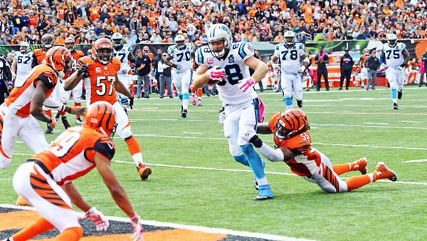 Cincinnati Bengals' linebacker Vontaze Burfict (55) brings down Carolina Panthers' tight end Greg Olsen (88). Burfict will miss the first three games of the season due to a suspension during the team's playoff loss to Pittsburgh. (David T. Foster, III/Charlotte Observer/MCT)