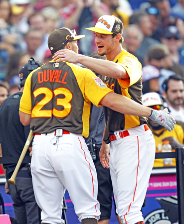 San Diego Padres' Wil Myers congratulates Cincinnati Reds' Adam Duvall, who eliminated him in the All-Star Home Run Derby at Petco Park in San Diego on Monday. (K.C. Alfred/San Diego Union-Tribune/TNS)