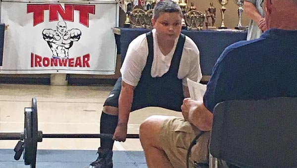 Ironton Middle School student Bryce Maynard  prepares to deadlift during the WNPF national championship competition. (Photos Submitted)