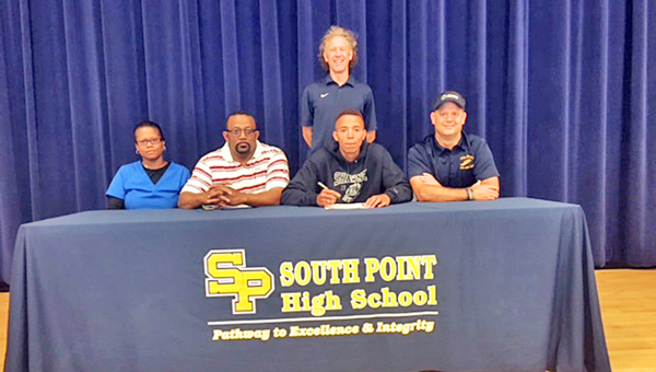 Former South Point Pointers' track standout Keion Dre Hill signed to play at Shawnee State University. Attending the signing ceremony were: seated left to right, mother Yvonne Hill, father Kenneth Hill, Keion Dre and South Point coach Todd Wells; standing is Shawnee State head coach Eric Putnam. (Photo Submitted)