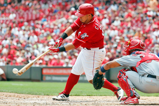 Cincinnati catcher Ramon Cabrera gets an RBI single off St. Louis Cardinals' reliever Seth Maness in the sixth inning of Thursday afternoon's game. Cabrera had three RBIs as the Reds blanked the Cardinals 7-0. (Photo Courtesy of The Cincinnati Reds.com/Jon Minchillo – Associated Press)