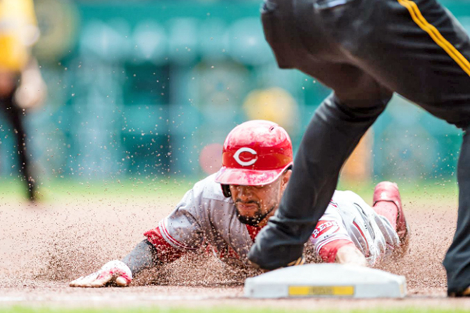 Cincinnati Reds' Billy Hamilton steals third base during the first inning of Sunday's game. Hamilton stole four bases, scored three runs and had three hits as the Reds beat the Pittsburgh Pirates 7-3. (Courtesy of the Cincinnati Reds.com/Justin Berl — Getty Images)