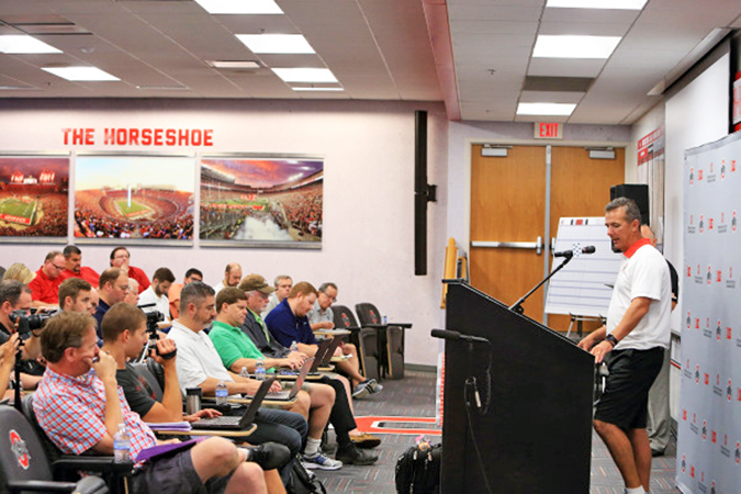 Ohio State Buckeyes' head football coach Urban Meyer talks with the members of the press during the team's media day on Sunday. Meyer has had mixed feelings so far with the team's progress. (Photo Courtesy of The Ohio State Buckeyes.com)