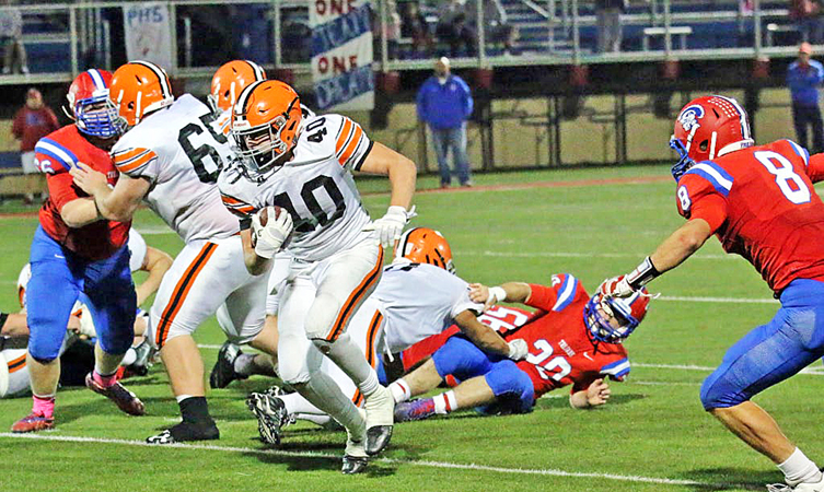 Ironton Fighting Tigers' running back Ethan Duncan (40) runs through a big hole in the Portsmouth defense during Friday's game. Ironton will travel to Coshocton on Saturday  to play in the Division V Region 19 quarterfinals of the OHSAA playoffs. (Tim Gearhart of Tim's News & Novelties, Park Ave. in Ironton)