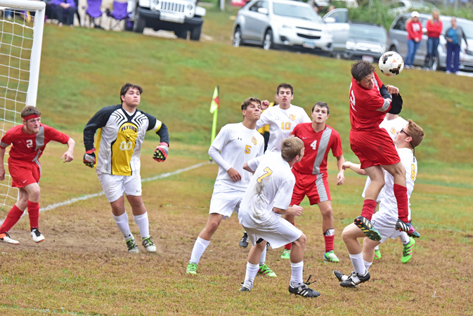 The St. Joseph Flyers' defense of goalkeeper Bradley Rist (00), Blake McKee (5), Clay Willis (10), Blake Balestra (7) and Daniel Hodges (6) surround a New Boston player during Saturday's Division III sectional tournament soccer game. The Flyers won 6-1. (Kent Sanborn of Southern Ohio Sports Photos)