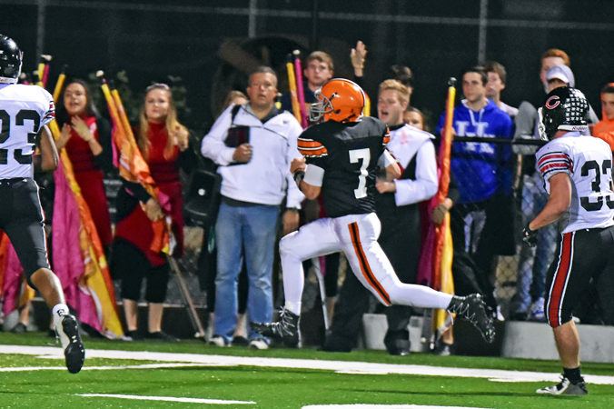 Ironton Fighting TIgers' quarterback Jake Isaac (7) races down the sidelines and into the end zone on a 38-yard touchdown run as time expired to end the first half. The score proved to be the difference as Ironton edged the Coal Grove Hornets 14-12 on Friday in a key Ohio Valley Conference game. (Kent Sanborn of Southern Ohio Sports Photos)