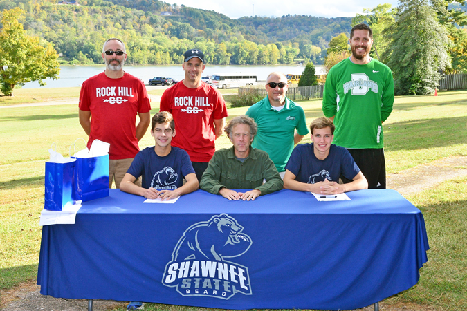 Shawnee State University cross country added two more runners to next year's team with the signing of Rock Hill Redmen senior Brendon McCormick and Fairland Dragons' senior Bryce Day. Attending the signing prior to the Ohio Valley Conference meet were: seated left to right, McCormick, Shawnee State head coach Eric Putnam and Day; standing left to right, Rock Hill assistant coach Michael Miller and head coach Mark McFann and Fairland Dragons head coach Chuck Wentz and assistant coach Adam Alt. (Kent Sanborn of Southern Ohio Sports Photos)