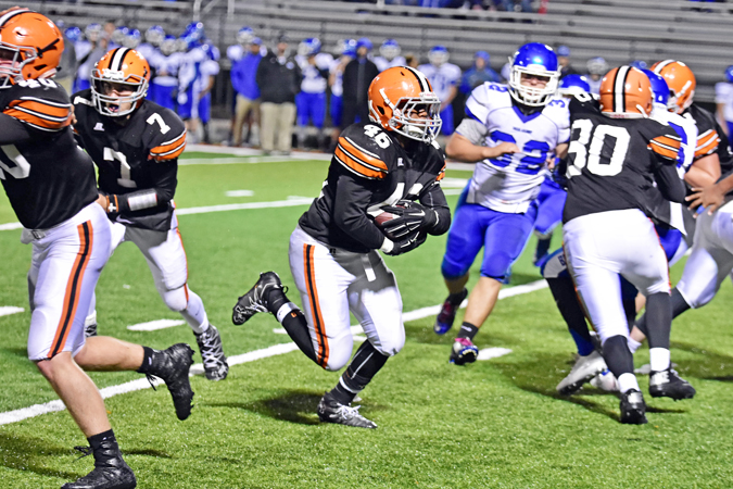 Ironton Fighting Tigers' running back Jaxson Pleasant runs through a big hole in the Gallaipolis defense for a 15-yard gain during last week's game. Ironton visits Portsmouth in the regular season finale and needs a win to secure a playoff berth and the OVC outright title. (Kent Sanborn of Southern Ohio Sports Photos)