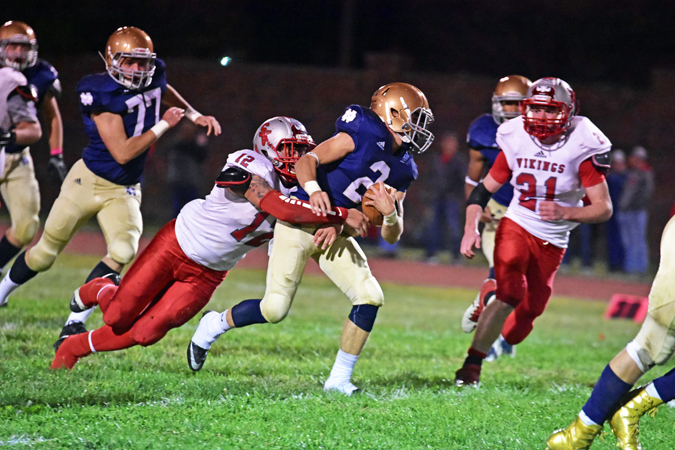 Symmes Valley Vikings' linebacker Jarod Sheppard (12) wraps up Portsmouth Notre Dame Titans' running back Sam Kayser (2) during Saturday's game. The Vikings lost 34-6. (Kent Sanborn of Southern Ohio Sports Photos)