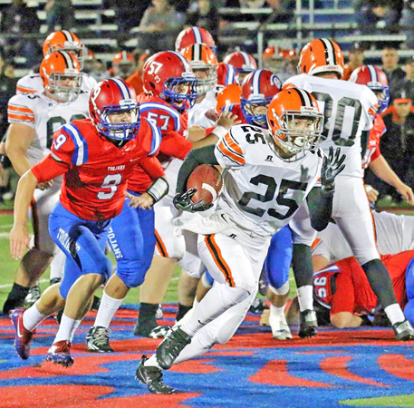 Ironton Fighting Tigers' Jourdyn Barrow (25) outruns Portsmouth Trojans' Luke Purdy en route to an 18-yard gain during last week's game. Ironton travels to Coshocton at 7 p.m. on Saturday in the Division V Region 19 playoff quarterfinals. (Tim Gearhart of Tim's News & Novelties on Park Ave., Ironton)