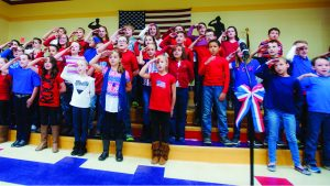 """Jessica St. James/The Tribune Fourth grade students perform songs such as """"American Tears,"""" """"Johnny Comes Marching Home,"""" """"All American,"""" and many more during a special Veterans Day program at Chesapeake Elementary School."""