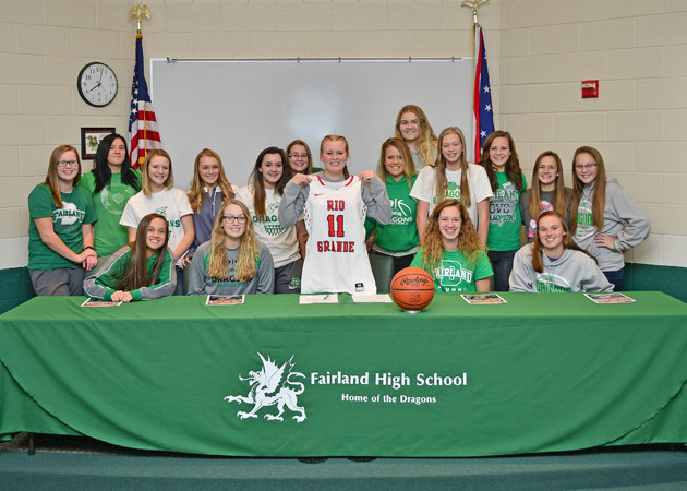 Fairland Lady Dragons' senior guard Issy McKinney signed a letter-of-intent on Monday to play basketball at the University of Rio Grande. McKinney holds up her Rio Grande jersey while being surrounded by her basketball teammates as they helped celebrate the milestone. (Kent Sanborn of Southern Ohio Sports Photos)