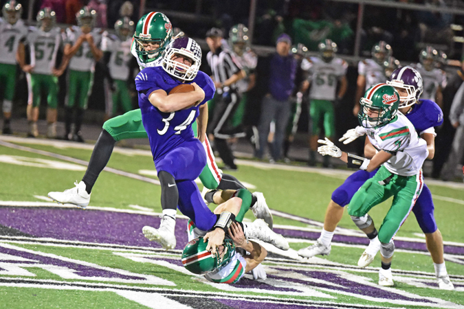 Chesapeake Panthers' fullback Will Scott (34) tries to slip through a tackle by a Barnesville defender during Friday's Division VI Region 23 quarterfinal game. The Panthers lost 41-22. (Kent Sanborn of Southern Ohio Sports Photos)