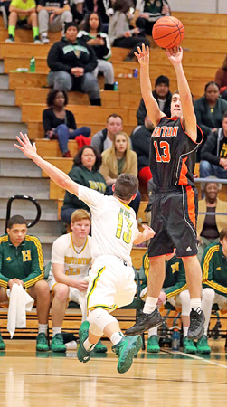 Ironton Fighting Tigers' guard Joel Blankenship (right) hits a 3-point goal over Huntington's Grant Subik during Wednesday's game. Ironton fell to the Highlanders 57-44. (Tim Gearhart of Tim's News & Novelties, Park Ave. in Ironton)